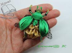 Ribbon beetle sculpture figure