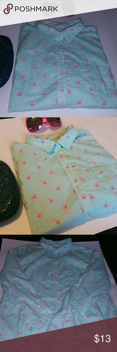 """**Merona Flamingo Pattern Button Down Shirt** Worn twice  Soft and light  Color is mint with pink flamingos  Button down and a front pockets.  Long sleeves  Size is Large  100% Cotton   Measures 21.5"""" across the bust  If you don't like the price please use the offer button.  If you have any questions please ask.  Sorry no trades   Have an amazing day!   """"Great Sense of Style"""" Merona Tops Button Down Shirts"""