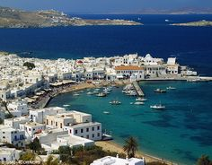 A white-painted wonder: Mykonos, with its natural harbour to the forefront,