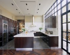 The same elements we are thinking about. Dark Cabs, White counters and gray tile floor  Jamie Herzlinger contemporary kitchen