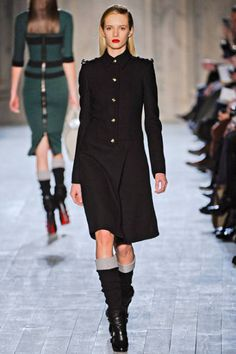 What's not to love about this Victoria Beckham Fall 2012 coat? The fabric cuffs on the boots are intriguing as well.