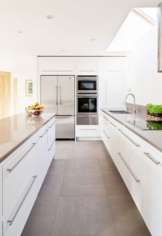 grey large format floor tiles, white kitchen