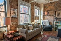 In 2012, Paul and Tina Sehlhorst bought an old, 1850s building on Main Street in OTR and converted it into their home. Despite a complete renovation, the original hardwood, exposed brick, steel beams, and elevator remain. / Image: Phil Armstrong, Cincinnati Refined // Published: 3.3.17