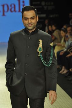 Actor Abhay Deol wearing an @Amrapali Jewels emerald and kundan polki double pin brooch at Indian International Jewellery Week 2012