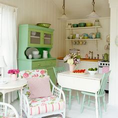 Tongue-and-groove wood panelling, freestanding furniture, and open shelving are the quickest ways to create a country look. Add shades of peppermint green and candy pink next to floral and polka dot fabrics for Fifties-inspired cottage chic.