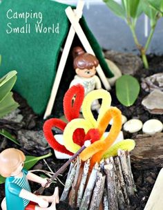 Use natural elements to make a camping small world scene for pretend play and sensory fun.