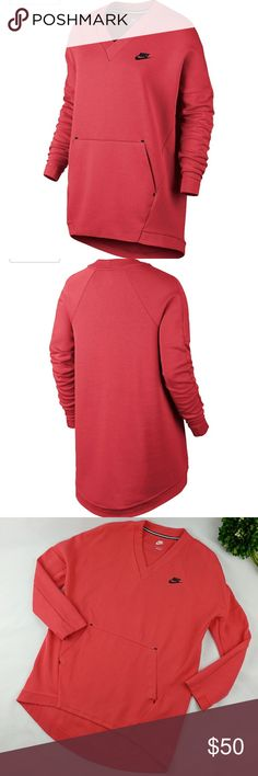 """Nike tunic high-low loose-fit sweatshirt Nike tunic high low loose-fit sweater Pink/coral color V-neck. Long drop-shoulder dolman sleeves. Kangaroo pocket In good gently used condition FABRIC: 67% cotton, 33% polyester Tech Fleece Armpit to armpit laying flat 23"""" Length on the back 32"""" Length in the front 27.5"""" Nike Tops Sweatshirts & Hoodies"""