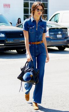 Kendall Jenner takes note from a bygone era, rockin' an all-denim jumpsuit with flared bottoms, not to mention old school-inspired round sunnies!