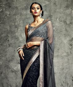 Indulge in the most beautiful and extravagant ethnic apparel this season. These sarees are available in some of the most mesmerizing shades and designs. So hurry and shop and now. Video: Design Highlights: Zari Embroidery with Stone Work and Lace BorderBRAND: Vikram Phadnis for VishalCATEGORY: Saree with Unstitched BlouseARTICLECOLOURMATERIALLENGTHSareeBlackNet5.50 metersBlouseBlackDupion0.80 meterWe would always want to send you what we showcase but there might be a slight variation in ...
