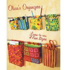 Olivia's Organizers. These can be made for office, bedroom, den laundry. Lots of possibility and oh so easy to just hand a cafe rod or two on the wall and hang as many as you need from a rod pocket top on them.