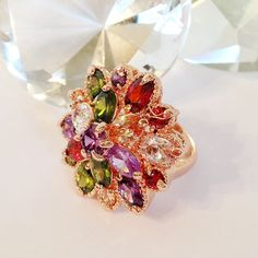 Gemstone Cocktail Ring with Giant Chocolate Diamond. My delicious hand molded solid chocolate diamond is sprinkled with glittering sugar to make it sparkle and shine. This delicious diamond is accompanied by a gorgeous high quality rose gold multi colored gemstone cocktail ring. By Diamond Chocolates
