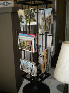 Having a postcard display seems like a fun addition to a home. Postcard Display, Brochure Holders, Where The Heart Is, Brochures, Postcards, Mirrors, Crafty, Fun, Travel
