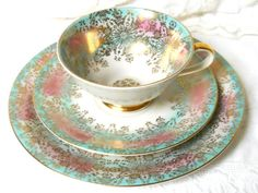 Lovely vintage floral tea cup trio decorated with turquoise, pink and gold on off white porcelain. Beautiful retro teacup trio! It was made by Winterling in Bavaria, Germany, probably in the fifties.   This set is in very good condition, no chips or cracks.  Please do not put it in the dishwasher!  947  For more vintage teacups visit our shop section: https://www.etsy.com/shop/minoucbrocante?section_id=12193676&ref=shopsection_leftnav_2  For more vintage items please visit our shop…