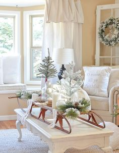 Cozy Farmhouse Christmas in the Front Room. Check out this vintage sled styled on the coffee table for Christmas! Farmhouse Christmas Decor, Outdoor Christmas Decorations, Rustic Christmas, Table Decorations, White Christmas, Elegant Christmas, Simple Christmas, Table Centerpieces, Vintage Christmas