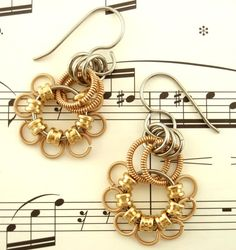 Zing went the strings of my heart! Guitar string earrings in a fun floral design!