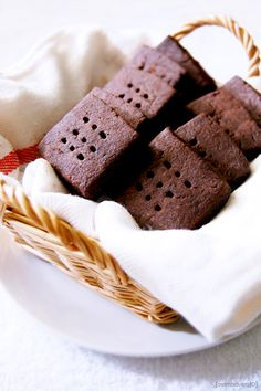 chocolate shortbread recipe...I say omit the vanilla essence and replace with either grand marnier or dark rum. Yum. Yum.  Oh, and use the darkest cocoa you can get (like the stuff from the Bulk Barn).