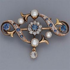 Sapphire, diamond, pearl and gold brooch. #GoldBrooches #diamondbroach  #VintageJewelry
