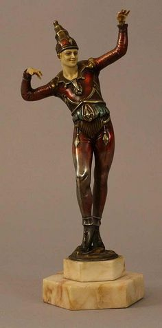 Art Deco sculpture of a harlequin, partly painted, on octagonal base, damages; French around 1920/30