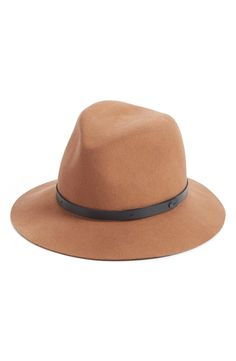 A raw-edged leather band encircles this stylishly floppy fedora made from rich, soft felted wool.
