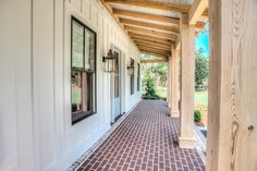 Tongue and groove porch ceiling; unfinished/clear sealant on notched out porch posts with clear yellow pine resting beam; board and batten exterior siding; pavers and brick accents; Custom Home Builders, Custom Homes, Modern Farmhouse, Farmhouse Style, Board And Batten Exterior, Brick Porch, Farmhouse Front Porches, Farmhouse Windows, Exposed Rafters
