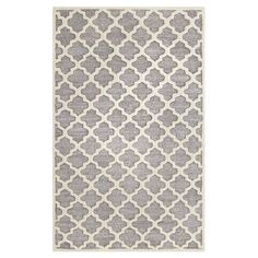 Anchor your living room seating group or define space in the den with this hand-tufted rug, showcasing a trellis motif in gray and beige.   ...