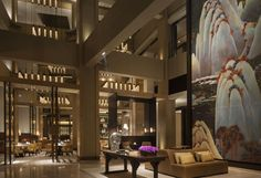 Rosewood Beijing lobby is a vertical courtyard with a contemporary interpretation of Shan Shui paintings