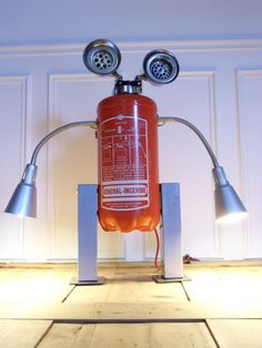 Robot lamp made with a recycled fire extinguisher #Art, #Assemblage, #FireExtinguisher, #Lamp, #Lights, #Metal, #Recycled, #Robot, #Sculpture, #Upcycling