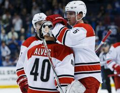 TAMPA, FL - DECEMBER 31: Emergency backup goalie Jorge Alves #40 of the Carolina Hurricanes is congratulated on his NHL debut by teammate Noah Hanifin #5 after the game against the Tampa Bay Lightning at Amalie Arena on December 31, 2016 in Tampa, Florida. (Photo by Scott Audette/NHLI via Getty Images)