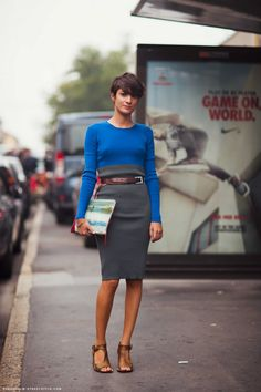 bright blue top, grey skirt, brown accessories