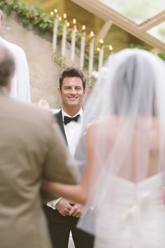 Love this shot of the groom seeing the bride and father all in one shot