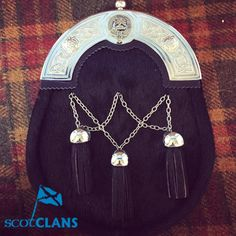 We have one in stock which we are selling at a massive discount.  This one has the Brodie Clan Crest on it.  It's a Dress sporran with chrome finish cantle featuring Celtic design with pewter crest in centre. Bovine dark skin covering with a cross chained. Free worldwide shipping available