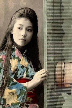 Vintage hand tinted portrait of a Japanese woman in Kimono