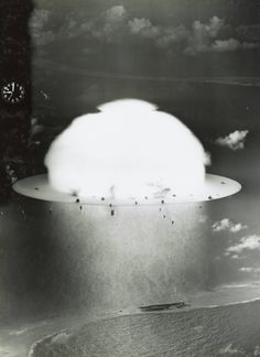 Mushroom cloud with ships evaporating below during 'Operation Crossroads' nuclear weapons test on Bikini Atoll, July 1946-