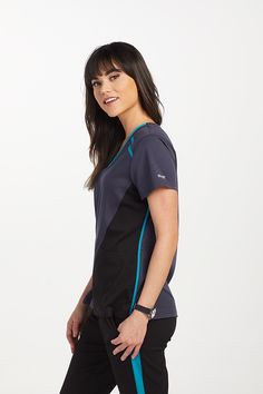 The Grey's Anatomy Spandex Stretch Contrast Panel Scrub Top is made with stretch fabric and roomy pockets. Greys Anatomy Men, Greys Anatomy Scrubs, Grey's Anatomy, Medical Uniforms, Phlebotomy, Nursing Shoes, Scrub Pants, Sporty Look, Scrub Tops