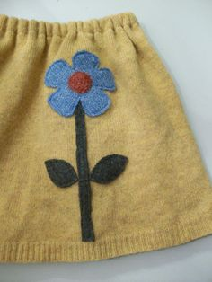 sweet, upcycled sweater to child's skirt. Have one already to be a jumper! Amazing how much better some of these sweaters look after they are felted!