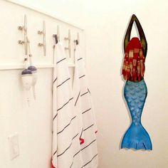 Love the beach towel hangers and the mermaid.