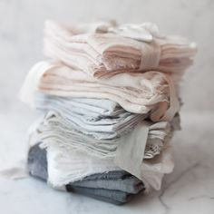 Pure cotton dinner napkins, carefully dyed in small batches, just like our ribbons!  Multiple colours in one order are possible - just message me to set up a custom order and let me know the colours youd like. There is a minimum of 4 napkins to an order.  Our dinner napkins are hand made by us in Portland from 100% cotton and carefully dyed using colours derived from plants, trees and soil. These processes - sometimes taking many days to achieve - lend a beautiful, delicate and unique colour…