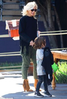 Fringe appeal! While out Gwen rocked a fringed black sweater and olive cargo pants with We...