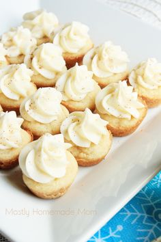 Classic sugar cookies baked in miniature muffin tins and topped with an eggnog cream cheese frosting and extra nutmeg - a wonderful sweet Christmas treat!