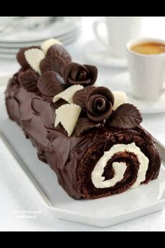 Yum outside.no to the inside b/c I just want the chocolate part! Moist fudge chocolate swiss jelly roll cake, stuffed with vanilla buttercream, and frosted with decadent chocolate ganache with vanilla accents from Enjoy Life. Chocolate Roll, Decadent Chocolate, Chocolate Desserts, Chocolate Ganache, Chocolate Swiss Roll Recipe, White Chocolate, Chocolate Roulade, Giant Chocolate, Chocolate Shavings