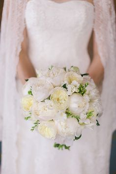 Classic All-White Styles - While we love scoping out all of the innovative floral designs that are out there, a monochromatic ivory bouquet will forever be timeless. Gardenia, ranunculus, lily of the valley, orchids and peonies are all stunning choices.