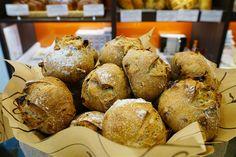 A basket of bread inside a Eric Kayser bakery