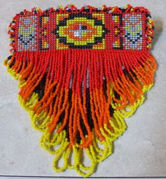 I really love the tribal looks that have been popping up. This is a barrette for your hair. I'd love to find just the perfect one to go against my dark brown hair.