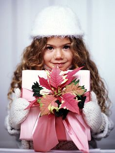 use a poinsettia flower to tie on top of a package