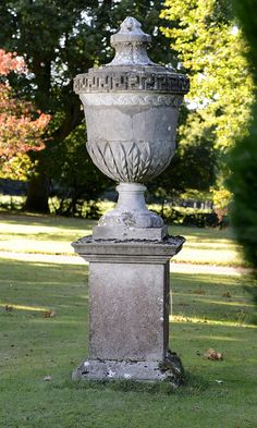 Set of four 65ins high limestone urns or urn finials, on pedestals, similar model to those at Chiswick House and Rousham by William Kent and Lord Burlington - sold at Summers Place Auctions in March 2017 for £26,000 inc premium and vat