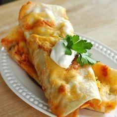 Creamy Chicken Enchiladas. i am so freaking hungry.