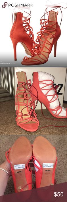 Schutz Fiorenza Heels Absolutely Gorgeous Heels! These are a salmon color with a dark red strap that ties up the leg. Purchased off Posh, but unfortunately they are too large for me. Size 9.5B. Comes with Box and dust bag. Just looking to make my money back. Please feel free to ask questions! SCHUTZ Shoes Heels