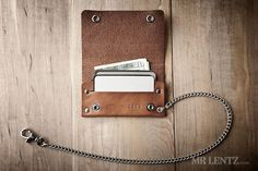 A thin biker wallet with two divided bill compartments, a credit card slot and double snaps to keep it all secure. This wallet comes in two styles: