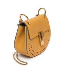 Chloe's Sunflower Drew in the mini size! Ooh la la! Love this bright one!  Get your Sunflower Drew at https://www.bagladyshop.com/products/chloe-mini-drew-sunflower-yellow-perforated-gold-leather-shoulder-bag-italy  www.BagLadyShop.com  #chloe #sunflower #yellow #gold #mini #drew #purse #chain #italy