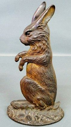 """Sold For $1,600 Bradley & Hubbard cast iron seated rabbit doorstop, 19th c. with traces of original paint decoration. 15.5""""h.x8.5""""w."""